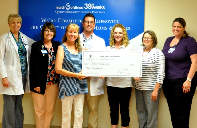 Picture of Halifax Health Team Members presenting a giant check to the TEARS foundation