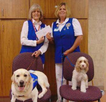 Photo of Halifax Health Auxilians and their therapy dogs.