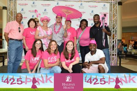 Photo of team members celebrating breast cancer awareness month.