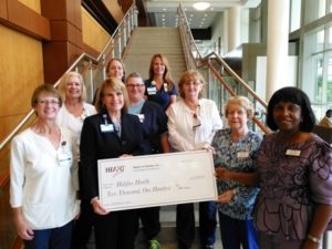 Photo of Halifax health nurses receiving check from Heart of Volusia, Inc