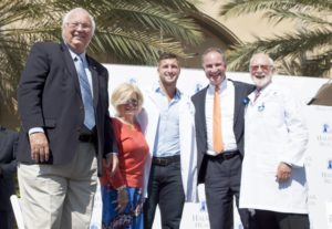 Photo of TIm Tebow and Halifax Health Team Members.