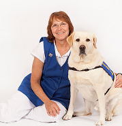 Photo of Barbara Bray and her Labrador retriever D'Jango