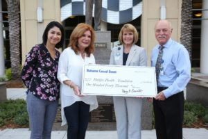 Picture of Halifax Health Development Manager Kathryn Nagib, Halifax Health-Foundation President Mary Bennett, Halifax Health Chief Communications Officer Ann Martorano and Halifax Health-Foundation Executive Director Joe Petrock with donation check from the Bahama Casual Fundraising Event