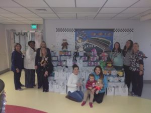 Picture of local Scentsy Distributors making toy donation to the Betty Jane France Center for Pediatrics at Halifax Health Medical Center of Daytona Beach