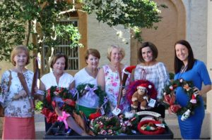 Picture of the Wreath Makers of St. Mary's Catholic Church presenting holiday wreaths to Halifax Health Medical Center of Daytona Beach
