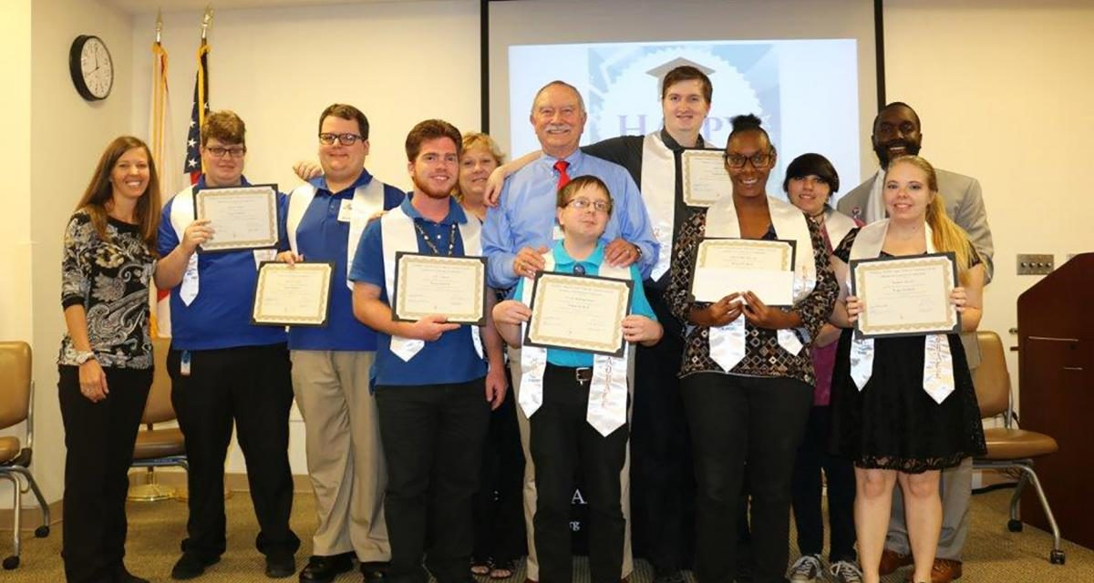 Project SEARCH students with diplomas