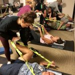 Image of a group of people doing an adaptive sports yoga class