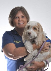 Photo of volunteer Tami Collins and one of Halifax Health therapy dogs