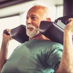 Photo of man working out on machine doing a shoulder exercise