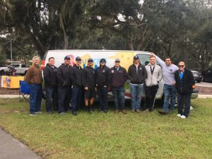 Picture of Palm Coast and Flagler Firefighters in front of van after receiving child passenger safety certification.