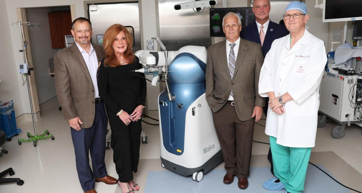 Picture of the Stryker's Mako Robotic-Arm Assisted Total Knee with Andrew Leech, Chairman, Halifax Health-Foundation Board of Directors; Mary Bennett, board member, Halifax Health-Foundation; Harold L. Goodemote II, Chairman, Halifax Health Board of Commissioners; Jeff Feasel, president and chief executive offices, Halifax Health; and orthopedic surgeon, Charles B. Williamson, M.D.