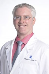 Headshot of Dr. Robert J Daly