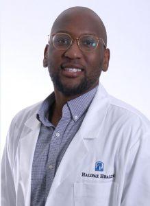 Headshot of Dr. Desir Hedson