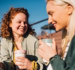 Two women talking outside and smiling