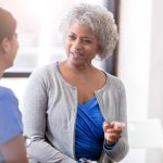 Cheerful senior woman talks with physician; Halifax Health