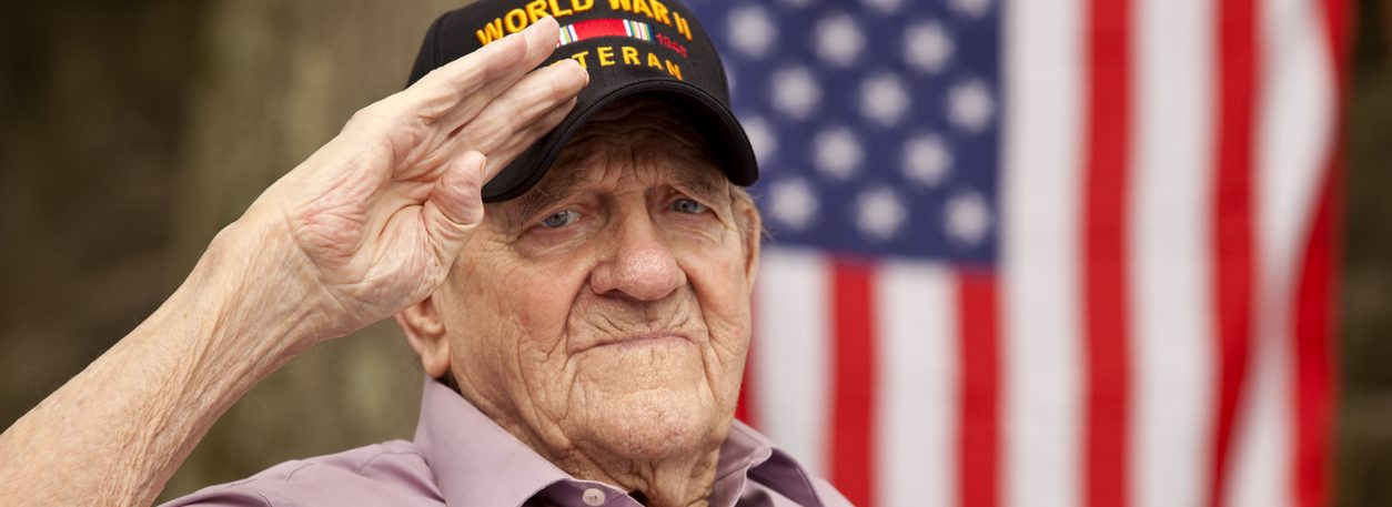 World War Two, Veteran wearing cap with text,