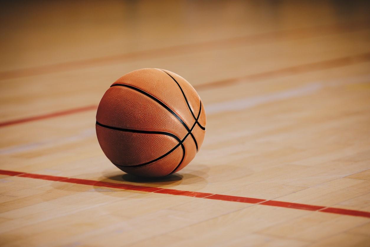 Image of basketball sitting still on basketball floor