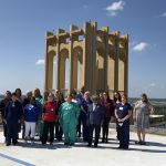Photo of Team Members on Helipad for Service Pin recognition